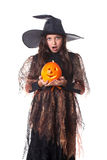 Girl in halloween costume with a pumpkin Royalty Free Stock Image