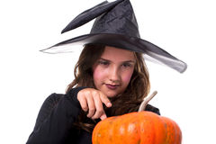 Girl in halloween costume with a pumpkin Royalty Free Stock Photo