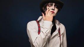 Girl with Halloween makeup posing in studio stock footage