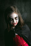 Girl in Halloween vampire costume Royalty Free Stock Photos