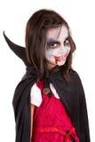 Girl in Halloween vampire costume Royalty Free Stock Image