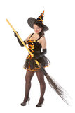 Girl in Halloween witch with broom. Sexy girl in Halloween witch with broom Royalty Free Stock Images