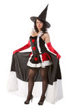 Girl in Halloween witch costume Stock Photography