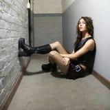 Girl in hallway. Caucasian female sitting in hallway Stock Image