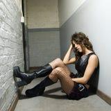 Girl in hallway. Caucasian female sitting in hallway Stock Photography
