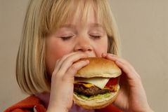 Girl hamburger. Royalty Free Stock Photography