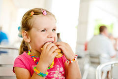 Girl with hamburger Stock Images
