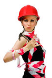 A girl with a hammer and a construction helmet royalty free stock photos