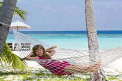 Girl in hammock. Young girl sleeping in hammock on the tropical beach Royalty Free Stock Photo