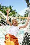 Girl in hammock. Little girl laying in a hammock Royalty Free Stock Images