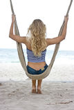 Girl in hammock Stock Images