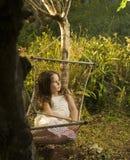 Girl in hammock. Little girl lying in a hammock in backyard Royalty Free Stock Images