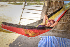 Relaxing in hammock. Young woman while relaxes on a hammock. A Conception Baja, California Sur, Mexico Royalty Free Stock Photos