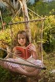 Girl in hammock dream. Little girl daydreaming in a hammock in backyard Royalty Free Stock Photos