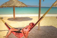 Woman in Hammock. Young woman relaxes on a hammock in Playa Telecote. La Paz, Mexico, Baja California Sur Stock Photography