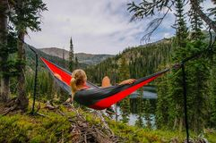 Girl in hammock beside lake Royalty Free Stock Images