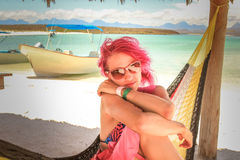 Woman in beach. Fashion woman on a hammock in tropical beach. Loreto, Isla Coronado, Mexico, Baja California Sur Stock Image