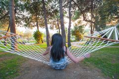 Girl in hammock swinging while admiring the green nature stock photos