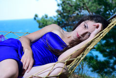 Girl in a hammock on a tropical coast Stock Photography