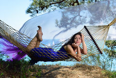 Girl in a hammock on a tropical coast Royalty Free Stock Images