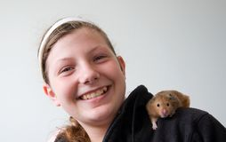 Girl with hamster on her shoulder Stock Photos