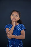 Girl with hand on chin Royalty Free Stock Photos