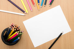 Girl hand drawing. Blank paper and colorful pencils on wooden table. Color pencils on wooden background. Hand and blank space Stock Photo