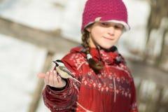 Girl feeding a bird stock photo