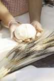 Girl hand with finished dough with grain Royalty Free Stock Image