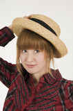 Girl with hand on hat vertical Stock Images