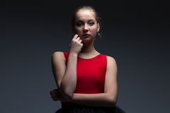 Girl with hand on her chin Stock Images