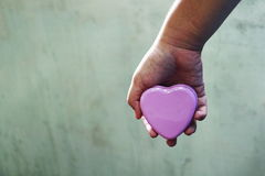 Girl hand  hold  heart Royalty Free Stock Photography
