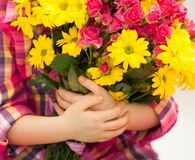 Girl hand is holding a bouquet of flowers. Spring, March 8, International Womens, Mothers day, family holiday Royalty Free Stock Photo