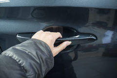 Girl hand holding car doorhandle Royalty Free Stock Image