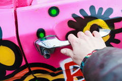 Girl hand holding doorhandle of pink colorful car Royalty Free Stock Photography