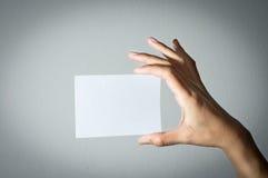 Girl hand holding paper. Stock Image