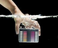 Girl hand holding water testing test kit royalty free stock photography