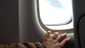 Girl hand on an illuminator of aircraft just before takeoff. And fly away stock video