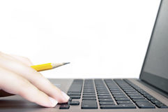 Girl hand and laptop on white. Girl hand with pen and laptop on white stock photo