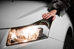 Girl hand laying on car hood Stock Photo