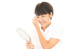 Girl with a hand mirror Stock Photo