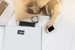 Girl hand with mobile, sleep exhausted on bed or late sleep Stock Images