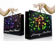 Girl hand pick up the holiday shopping bag Stock Photo