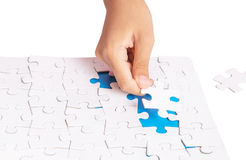 Girl Hand Playing Jigsaw Puzzle II Royalty Free Stock Photo