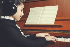 Girl hand playing piano royalty free stock image