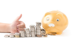 Girl hand with thumb up with money coin stack isolated Stock Photos