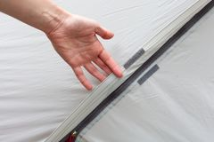 Girl hand unzip the entry of camping tent on rainfly/. Girl hand unzip the entry of camping tent on rainfly Royalty Free Stock Images