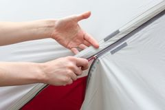 Girl hand unzip the entry of camping tent on rainfly. Girl hand unzip the entry of camping tent on rainfly Stock Photo