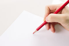 Girl hand write something Stock Photos