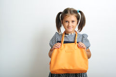 Girl with handbag Stock Photos